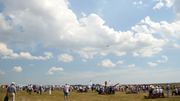 12 August 2016, Kazan, Russia - Kurkachi air show: the crowd at the festival looking at planes performs aerobatics low to the ground