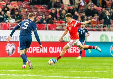 Moscow, Russia - October 10, 2019. Russia midfielder Aleksandr Golovin against Scotland national football team centre back Michael Devlin during UEFA Euro 2020 qualification match Russia vs Scotland (4-0) in Moscow.