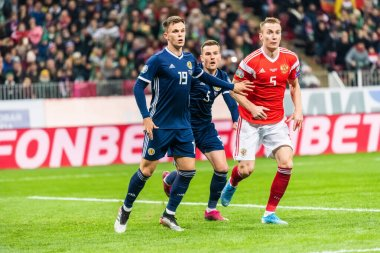 Moscow, Russia - October 10, 2019. Players Lawrence Shankland, Michael Devlin and Andrey Semenov during UEFA Euro 2020 qualification match Russia vs Scotland (4-0) in Moscow.