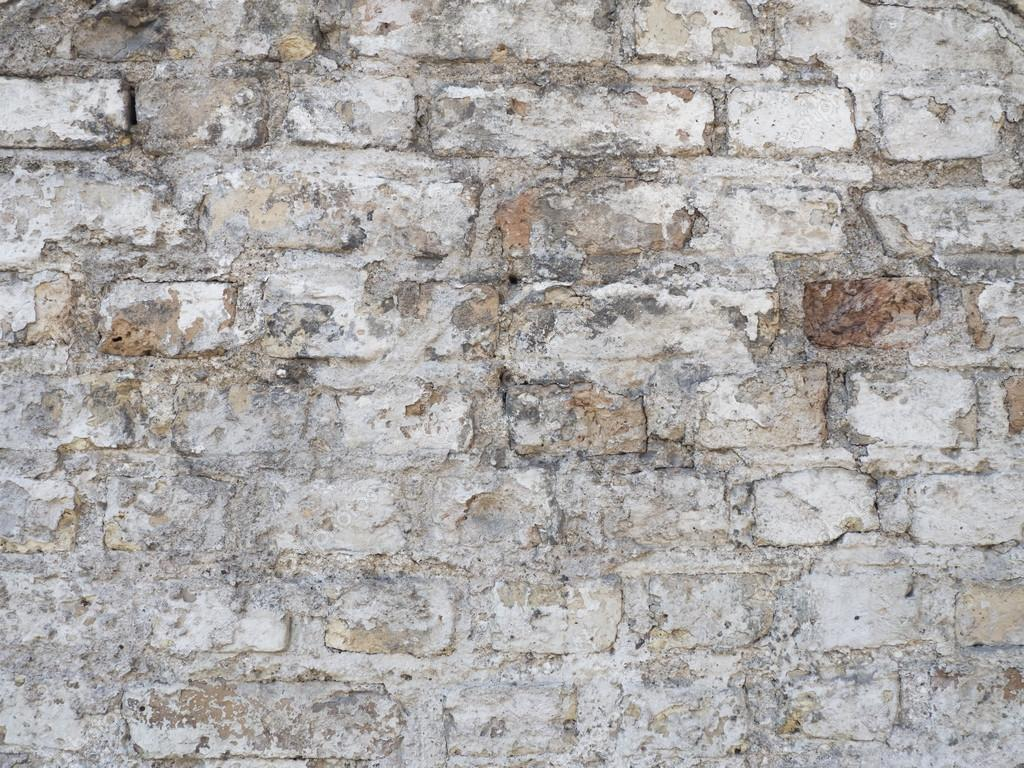 Old Damaged Rustic Brick Wall With Plaster Texture Background Stock Photo