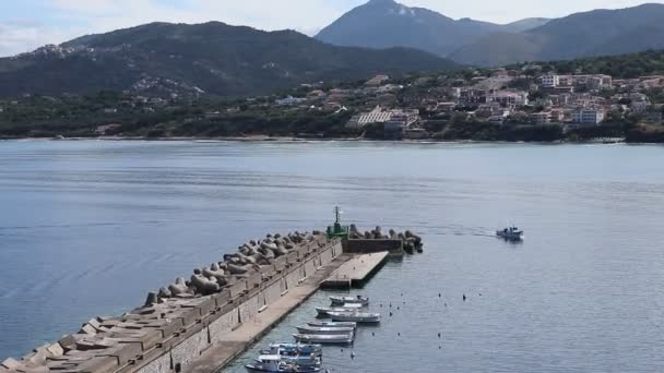 Palinuro, Campania, Italy - June 8, 2020: Boat arriving at the port from the top of the path of the towers