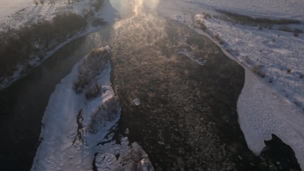 Early Morning Aerial View on the Frozen River, Scenic Landscape at Sunny Winter Day, 4k Drone Video