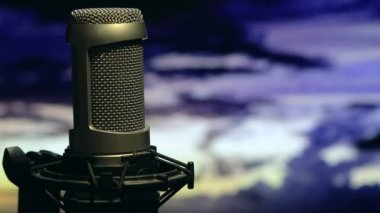 Isolated Microphone On Stand Background Cloudy Sky