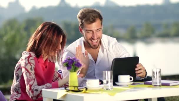 Businesspeople having online meeting using tablet
