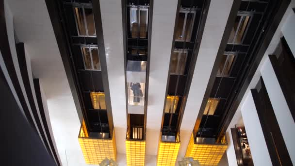 Above view of rising elevator car with hotel guest