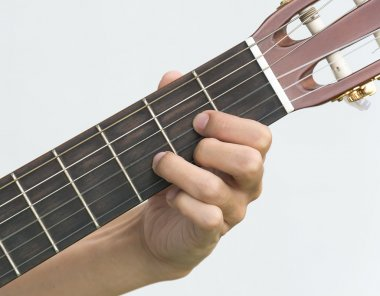 hand playing on  guitar