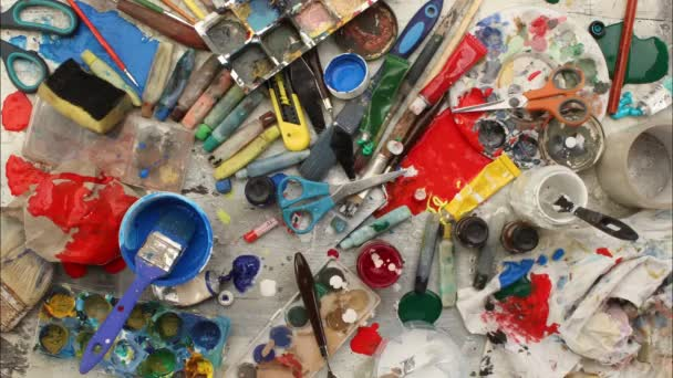 Cleaning up artist desk full of art supplies