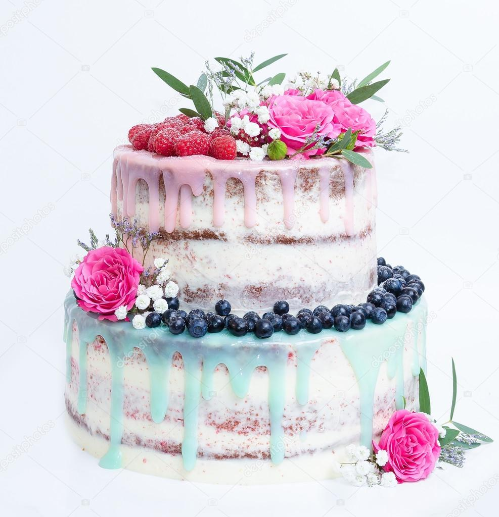 wedding color drip cake with roses blueberries and raspberries stock photo. Black Bedroom Furniture Sets. Home Design Ideas