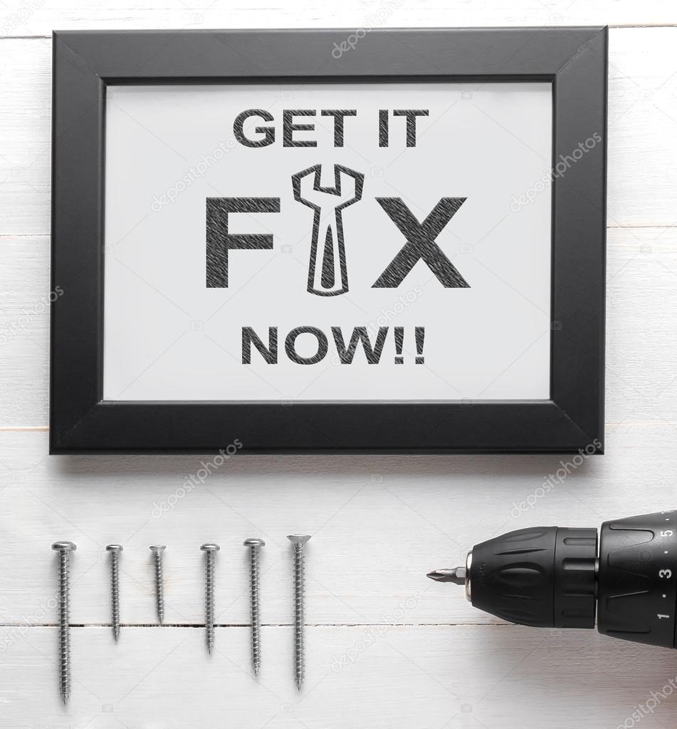 Fix Bel ons nu tekst op zwart frame met nagels en schroevendraaier ...