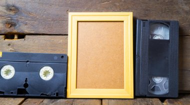 Video tapes and Blank wooden frame template copy space