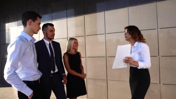 Business Team Boss Subordinates Discuss Near Center Office