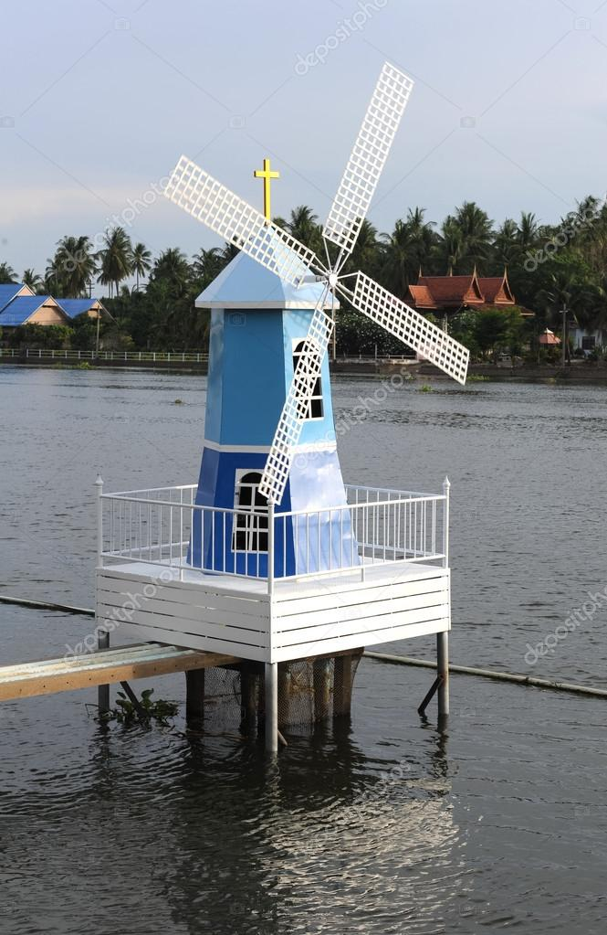 Wind mill in the river.