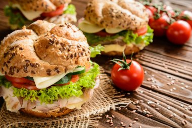 Fish burger with mackerel meat, cheese and fresh vegetable