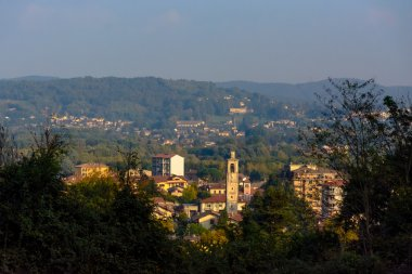 Top view of a city in Italy. In the distance are the mountains. Italy. Angera