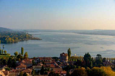 Top view of a city in Italy. In the distance are the lake. Italy. Angera