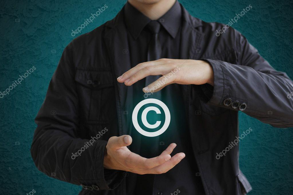 Man Holding Copyright Symbol Concept Image For Illustration Of