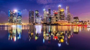 Singapore city skyline at sunrise.