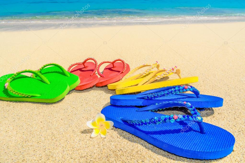 3981913c8 Colored sandals at the beach — Stock Photo © Twenty2Photo  116494408
