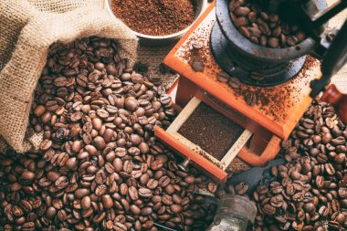 Coffee beans and a coffee grinder