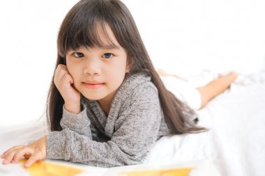 portrait asia children, education and school concept -student girl reading book