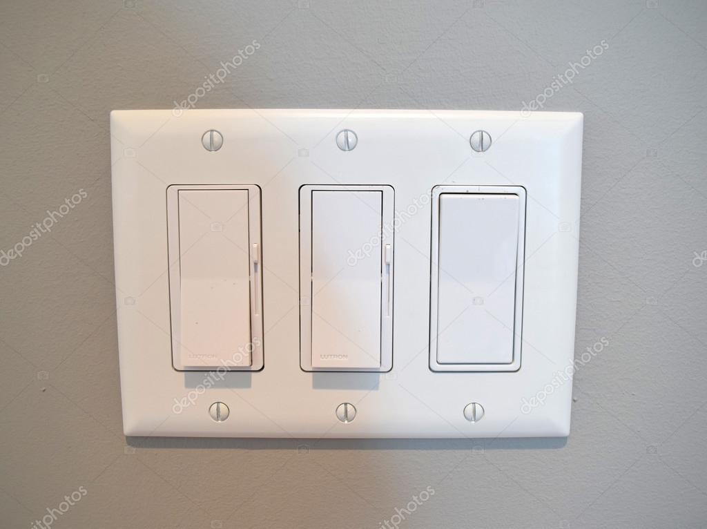 Moderne Lichtschalter im Haus — Stockfoto © cabecademarmore #124644480