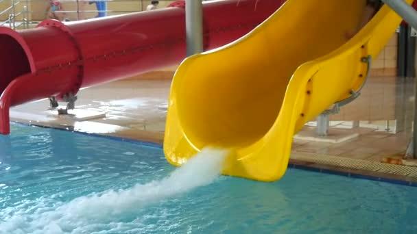 Teen Enjoying Ride On Water Slide