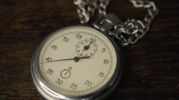 Stopwatch on the brown wooden table