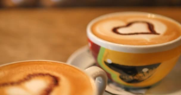 Two cups of coffee on the table, latte art