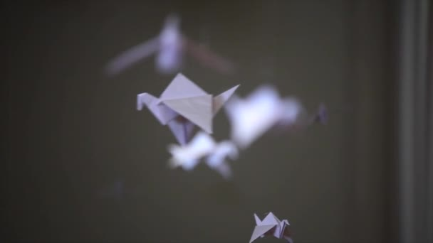 many of origami bird hanging in a row