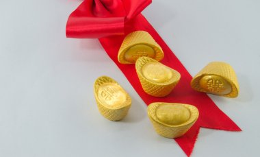 Gold ingot Red ribbon bow on white background.