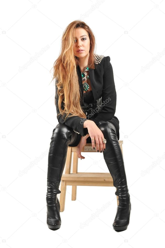 84bee6aa485 Women wearing black jacket and black socks and long leather boots with long  brown hairs in