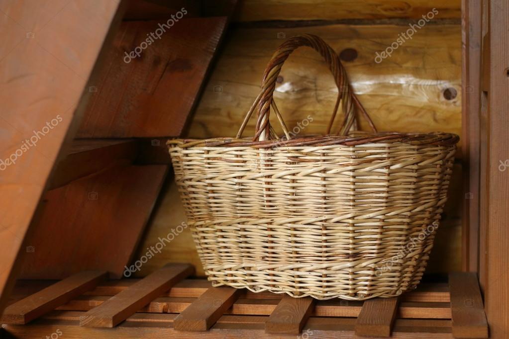 Wicker Basket Under The Stairs. U2014 Stock Photo