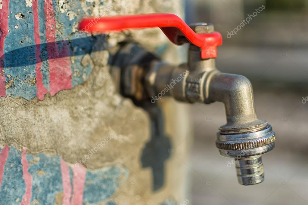 Faucet on Old Cracked Blue Painted Wall. Red Handle Water Tap ...