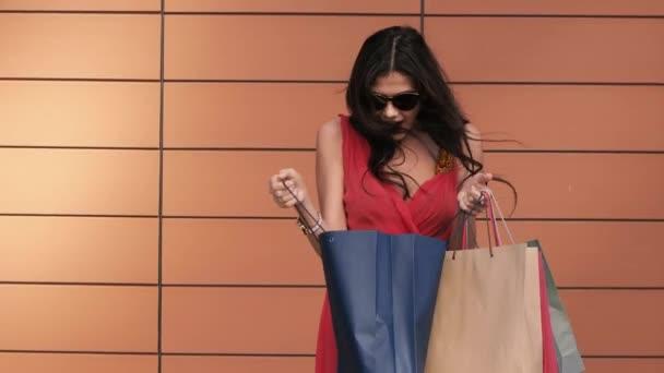 Beautiful lady enjoying her purchases