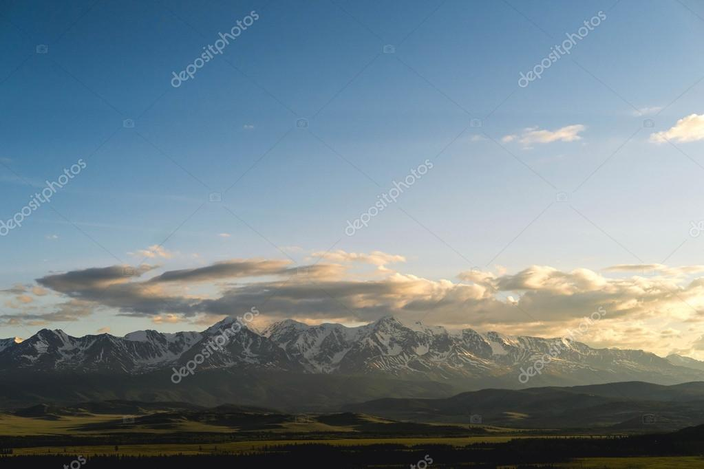 Kurai steppe and North Chuya ridge at the dawn. Clouds and Mountains