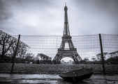 Eiffel tower and umbrella on a rainy day