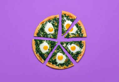 Slices of pizza with spinach, eggs and mozzarella, isolated on purple background. Sliced vegetarian pizza, flat lay. Tasty homemade florentine dish.