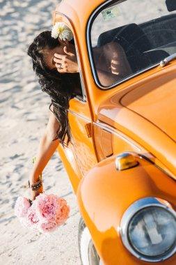 bride near the car