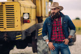 Bearded cowboy by harvester