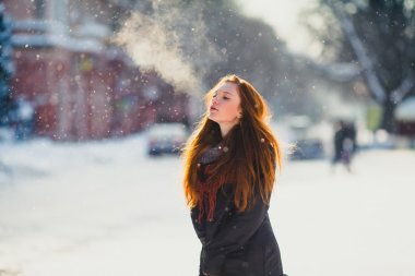 redhead girl in frozen winter day