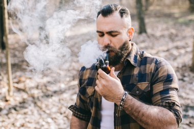 Bearded man smoking pipe