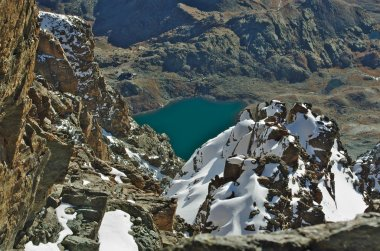 Lake and hut seen from high above Monviso