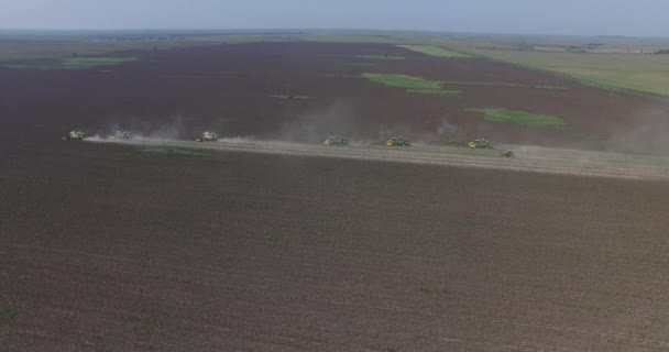 Sunflower field harvest. Farming Equipment Food Modification Crop Concept. Clouds of dust and smoke from the harvesters