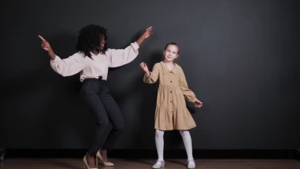 Afro-american stepmother and white adopted daughter dance