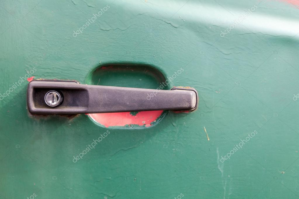 close up of a black plastic car door handle the vehicle door is