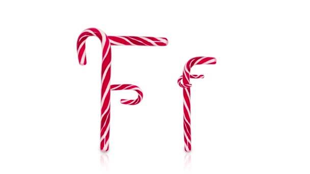 Zastavit animaci pohybu. Anglická abeceda z vánočních cukrovinek izolované na bílém pozadí.