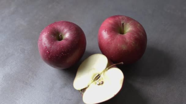 fresh red apples on a gray base