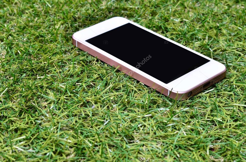 Smartphone on grass background