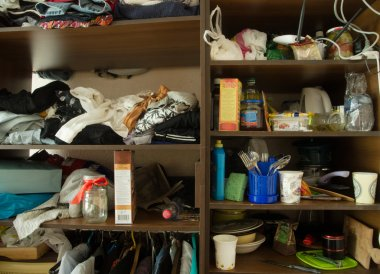 clutter in cabinets, dormitory