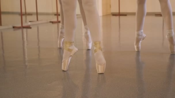 Teenage girls dance in a ballet Studio, close-up of feet in Pointe shoes.